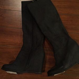 Pegabo black leather knee high boots.